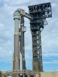 Starliner atop the Atlas V rocket with Crew Access Arm deployed